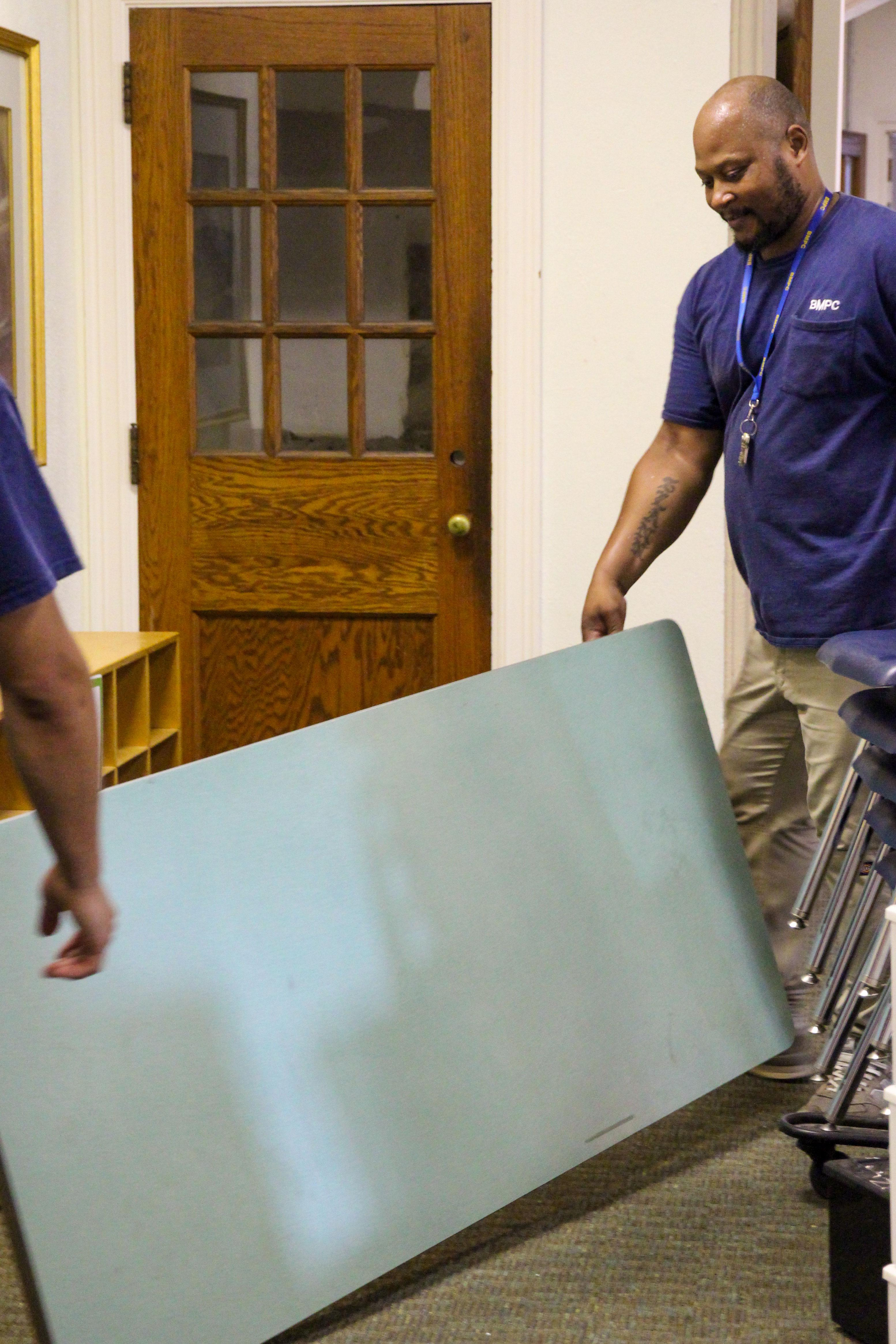 Facilities Staff Moving Tables